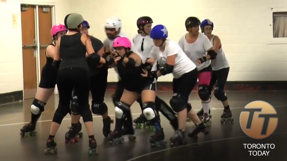 A photo of nine people on roller skates, who are holding onto each other and look to be in motion. 'TORONTO TODAY' is written in white font in the bottom right corner, with 'TT' carved out of an orange circle above it.