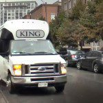 A photo of a white van driving down a street, with 'KING' written in a grey bubble at the front of the car. 'TORONTO TODAY' is written in white text, with 'TT' carved out of an orange circle above.