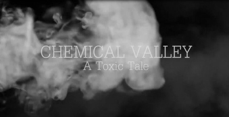 'CHEMICAL VALLEY' is written in white text, with 'A Toxic Tale' written below it, and smoke behind the text on a grey background.