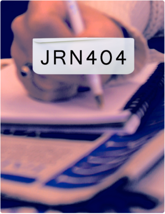 JRN 404 is written in black text, with someone writing in a notebook in the background.