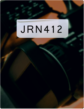 JRN 412 is written in black text, with a camera lens in the background.