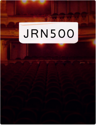 JRN 500 is written in black text, with an auditorium in the background.