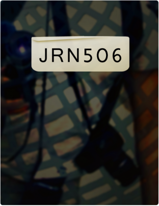JRN 506 is written in black text, with a blurred black, white and blue background.