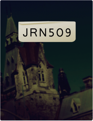 JRN 509 is written in black text, with an stone building with a pointed roof in the background.