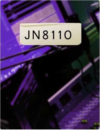JN 8110 is written in black text, with a control room in the background.