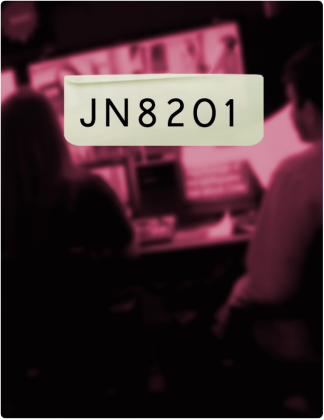 JN 8201 is written in black text, with two students sitting in front of screens blurred in the background.