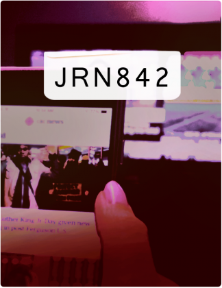 JRN 842 is written in black text, with a phone screen and computer screen in the background.