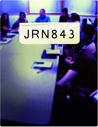 JRN 843 is written in black text, with people gathered around a conference table in the background.