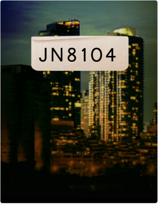 JN 8104 is written in black text, with two tall buildings in the background.