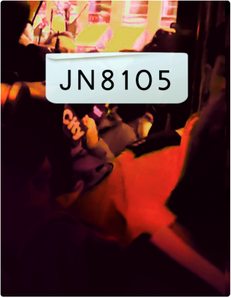 JN 8105 is written in black text, with reporters holding microphones in the background.