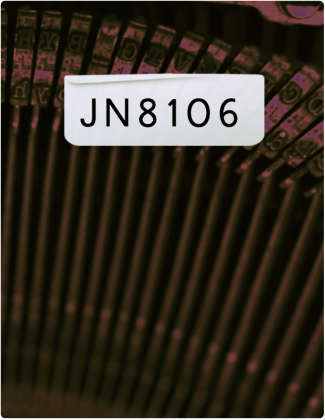 JN 8106 is written in black, with a close up shot of a typewriter in the background.