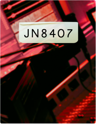 JN 8407 is written in black text, with a control room in the background tinted red.