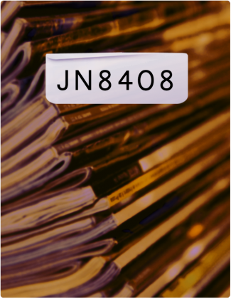 JN 8408 is written in black text, with books stacked in the background.