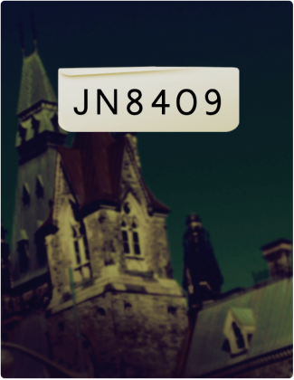 JN 8409 is written in black text, with an old, large stone building with a pointed roof in the background.