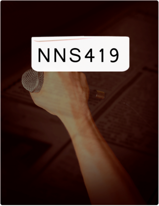 NNS 419 is typed in black font with a hand holding a microphone in the background.
