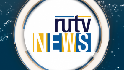 'rutv' is written in dark blue font, with 'NEWS' underneath on a combination of blue and yellow outlines. The text is in a white circle, on a dark blue background.