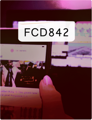 FCD842 written in black text, with a cell phone in the background.