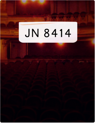 JN8414 written in black text, with an auditorium in the background.