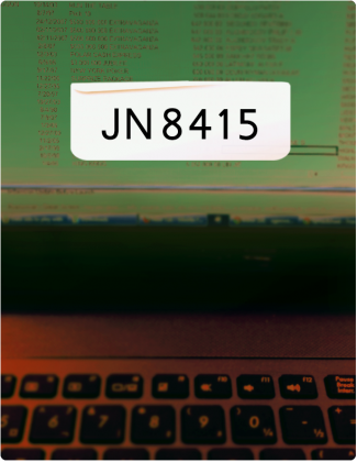 JN8415 written in black text, with a laptop screen and keyboard in the background.